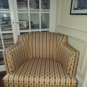 Before we reupholstered this chair, it looked a little bland and sad.