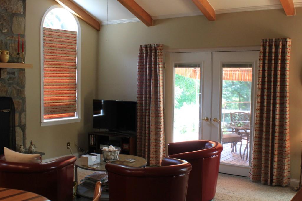living room with custom drapes