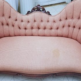 before reupholstering an antique loveseat