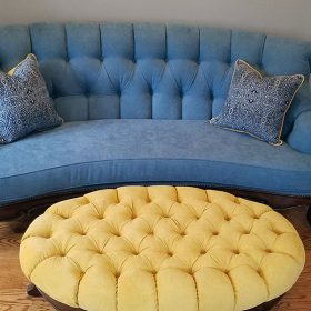 antique sofa reupholstered in blue with yellow custom upholstered antique ottoman