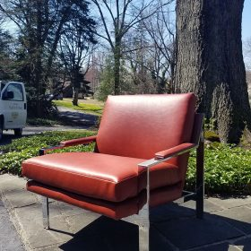 red leather chair reupholstered in recycled leather