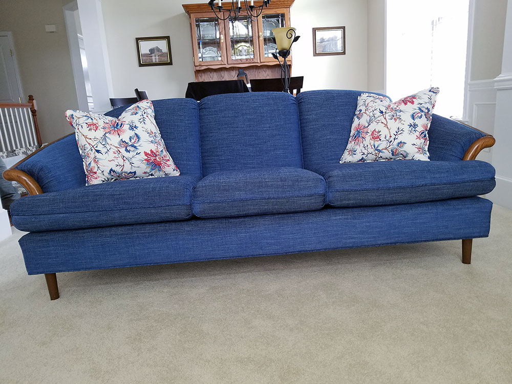 modern blue sofa with matching throw pillows