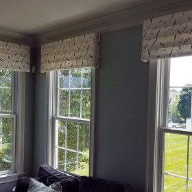 three valances in a patterned white fabric